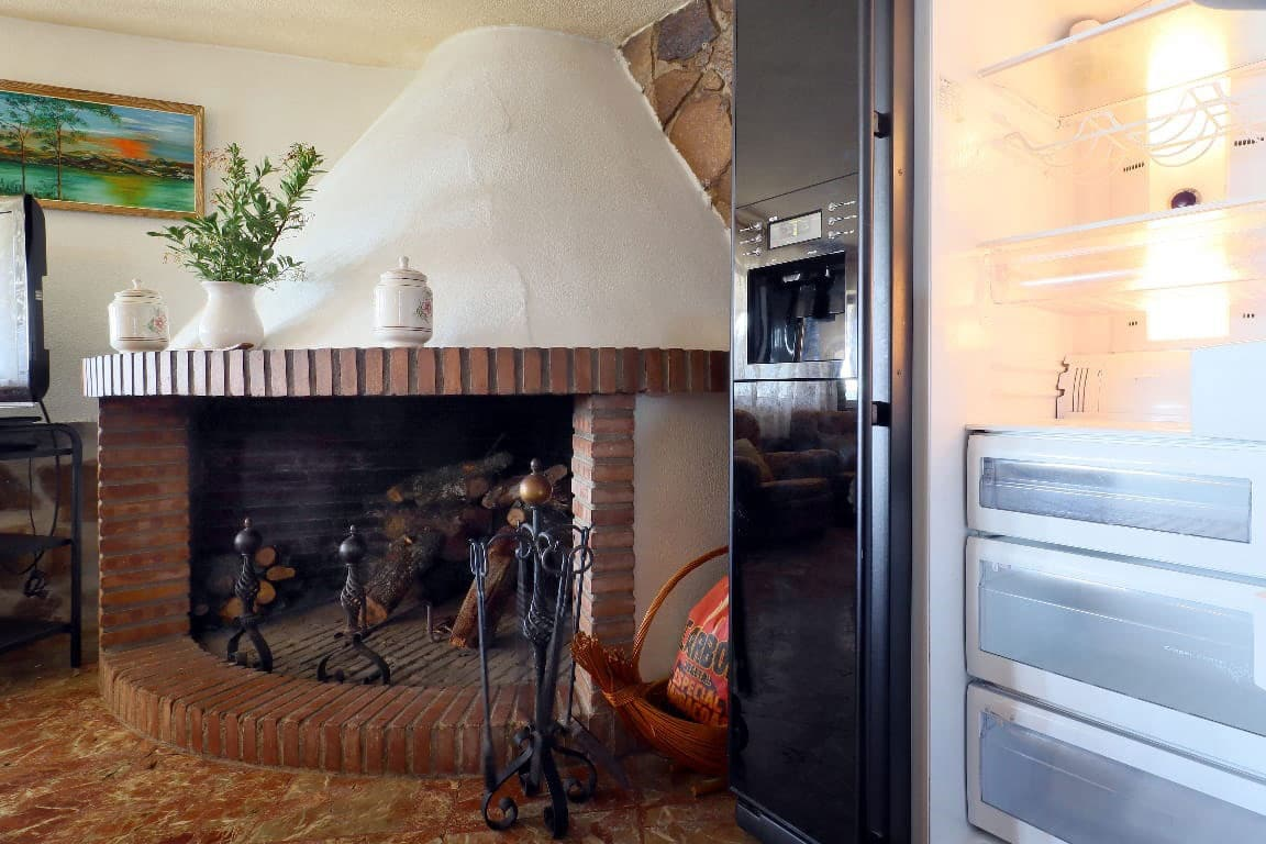 Fireplace in rural house in Cordoba. Muriano Hill